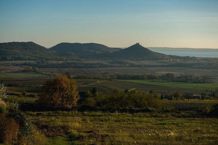 Badacsony Badacsony Wine Region Balaton Beauty In Nature Blue Day Hungary Landscape Mountain Nature No People Outdoors Rock Scenics Sky Sun Sunset Szigliget Szigliget Castle Wineregion