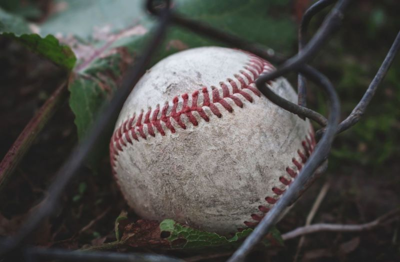 Close-up of old baseball ball on land