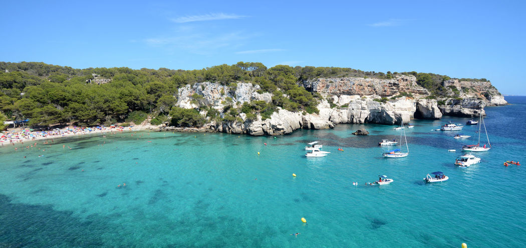 cala Macarella Macarella (Menorca) Aerial View Beach Beauty In Nature Blue Day Nature Nautical Vessel Outdoors Rock - Object Sailboat Sailing Sailing Ship Scenics Sea Sky Summer Swimming Tranquil Scene Tranquility Travel Destinations Tree Vacations Water Yacht