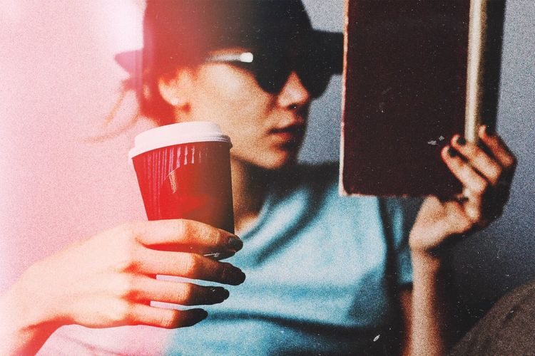Coffee time Holding Sunglasses Women Indoors  Close-up Coffee Lifestyles