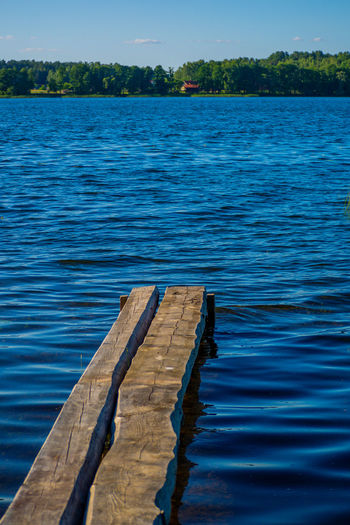 Close-up of wooden posts in lake