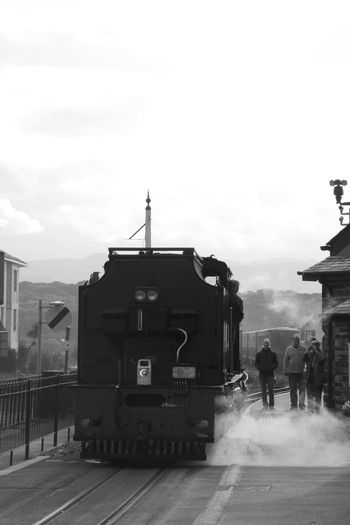 The only way to travel. Architecture Building Exterior Built Structure City City Life Cloud - Sky Day Entrance Façade Famous Place Footpath History In Front Of Monochrome Monochrome Photography Old Times Outdoors Person Sky Smoke Steam Tourism Train Wales