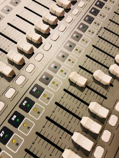 Sound Mixer Full Frame Music Technology In A Row Sound Recording Equipment Control Audio Equipment No People Arts Culture And Entertainment High Angle View Control Panel Indoors  Repetition Large Group Of Objects Studio Knob Industry Equipment