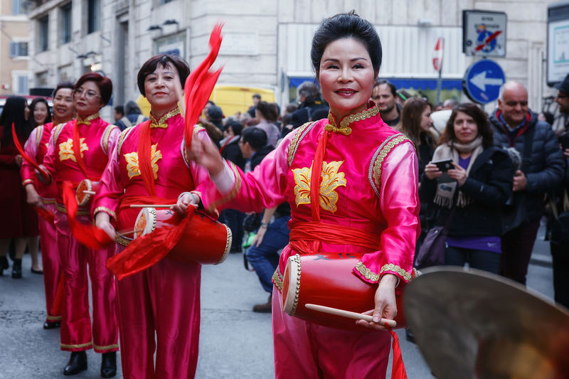 Rome, Italy - January 28, 2017: Chinese women in traditional dress, play and dance through the streets of the capital, during the procession celebrating the Chinese New Year in the year of the rooster. Adult Bongo Drum Chinese Culture Chinese Instruments Chinese Lady Chinese New Year Cymbals Day Outdoors Percussion Instrument Play And Dance Real People Traditional Clothing Women Women Around The World