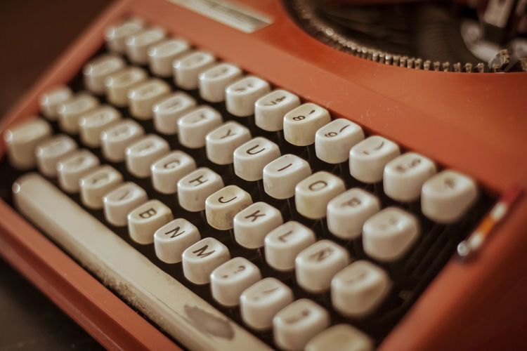 old typewriter Close-up Selective Focus Technology Indoors  Number High Angle View Communication No People Table Text Calculator Western Script Finance Typewriter Business Letter White Color Still Life Large Group Of Objects Sign Push Button