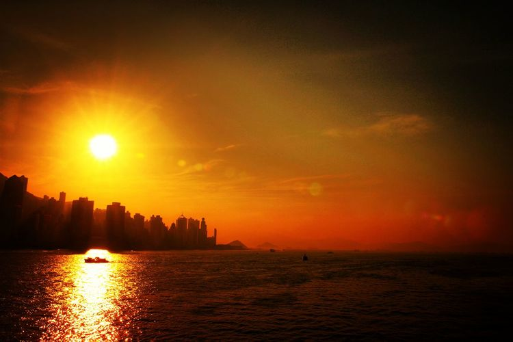 Victoria Harbour's Sunset Evening Hk Seaview Silhouette City Hong Kong Dusk Dusk In The City Golden Hour Travel Sunset City Urban Skyline Outdoors Vacations Travel Destinations Beauty Water Cityscape