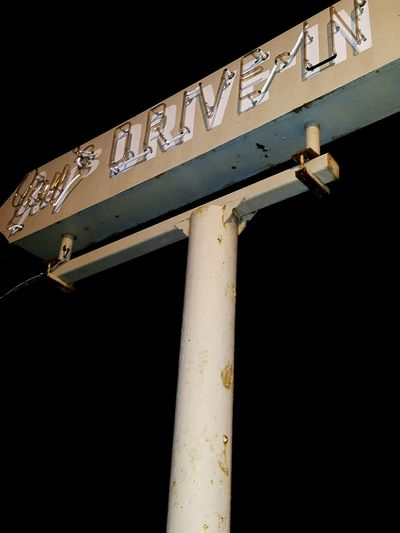 Dramatic Angles Overnight Success Low Angle View Outdoors Retro Styled Neon Sign Small Town, USA Night