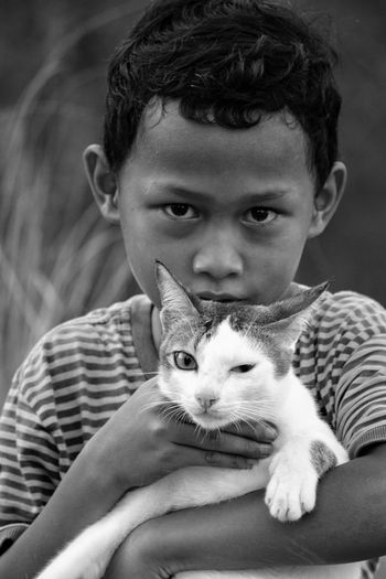 Portrait Of Boy With Cat