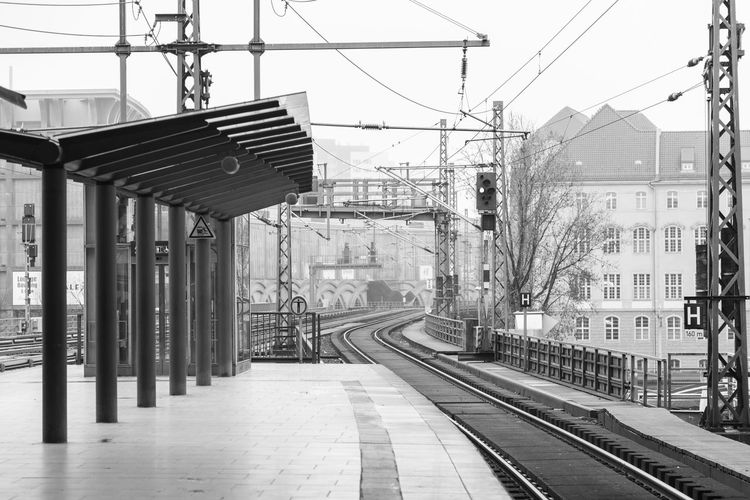 Architecture Building Building Exterior Built Structure Cable City Complexity Day Electricity  Electricity Pylon Mode Of Transportation Nature No People Outdoors Power Line  Power Supply Public Transportation Rail Transportation Railroad Station Platform Railroad Track Sky Track Transportation