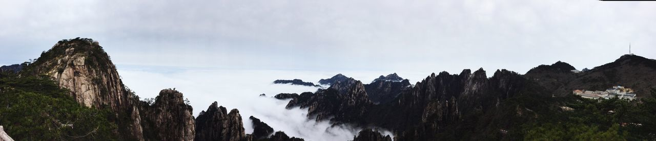 Panaromic view at the top of Lion Peak on Huangshan Sky Mountain Nature Beauty In Nature Tranquility Scenics Low Angle View Cloud - Sky Non-urban Scene Tranquil Scene Day Mountain Range No People Outdoors Landscape Tree Huangshan Huangshan Mountains Panaromic View Panaroma China