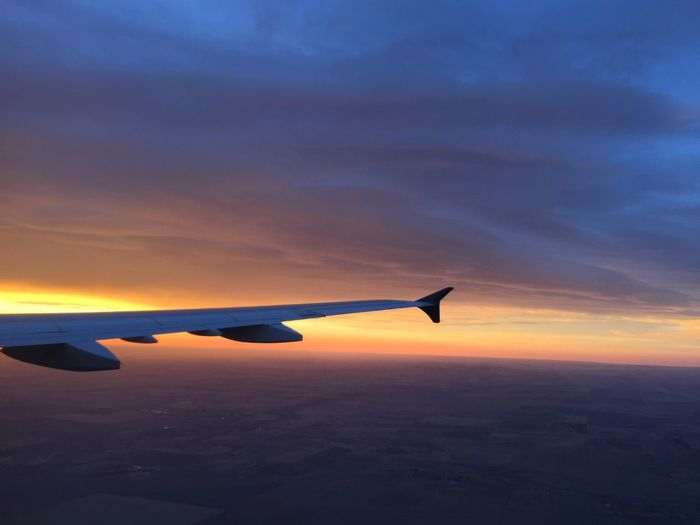 Air Vehicle Aircraft Wing Airplane Airplane Wing Beauty In Nature Cloud - Sky Flying Journey Nature Scenics Sky Sunset Transportation