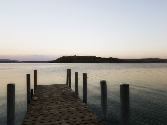 Evening at the lake side Lake Water Clear Sky Sunset Wooden Post Sand Wood - Material Sky Horizon Over Water Pier