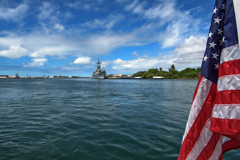 View of Pearl harbor and the USS Missouri memorial Battleship Flag Harbor Memorial Nautical Vessel Navy No People Outdoors Patriotism Pearl Harbor Politics And Government Stars And Stripes Flag Travel Destinations USA USS Missouri Water Water Reflections