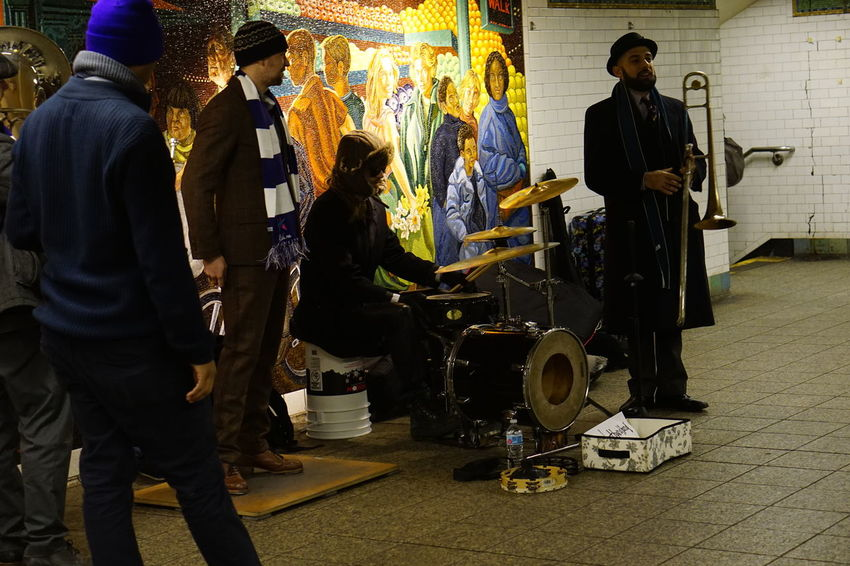 A band of Buskers entertain subway passengers in New York City's Times Square station. New York City Underground Arts Culture And Entertainment Buskers Drum - Percussion Instrument Men Music Musician People Performance Real People Standing Subway Trombone