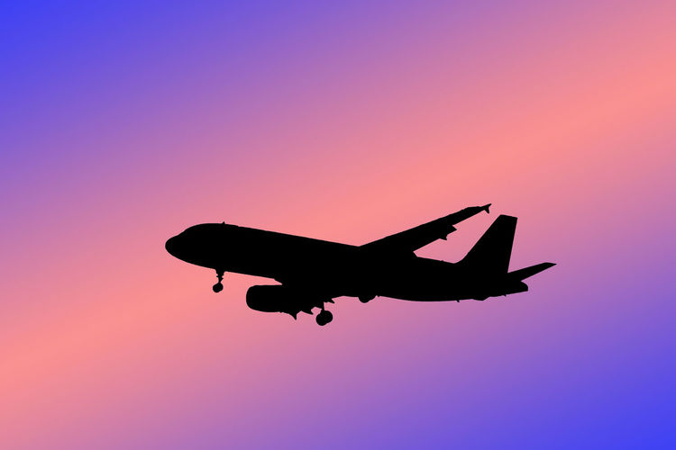 silhouette of airplane Eeyem Photography EyeEm Best Shots EyeEm Selects Transportation Aerospace Industry Air Vehicle Airplane Clear Sky Copy Space Flying Illustration Low Angle View Mid-air Mode Of Transportation Motion Nature No People on the move Outdoors Plane Silhouette Sky Sunset Transportation Travel