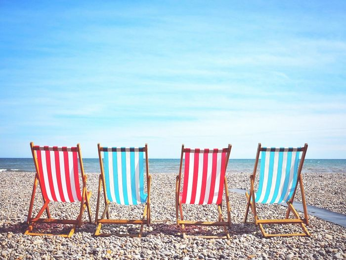 Taking the sea air at Beer. Beer Devon Sea Seaside Sea And Sky Deckchairs Pebbles Beachphotography Beach Devon UK Uk England United Kingdom Seascape Striped Pattern Chairs