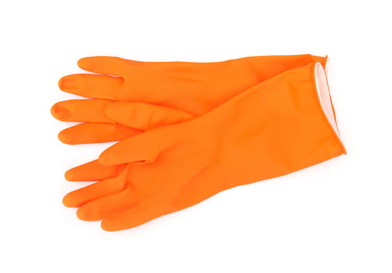 Orange color rubber gloves for cleaning on white background, housework concept Cleaning Colors Glowing Housework Orange Color Rubbish White Background