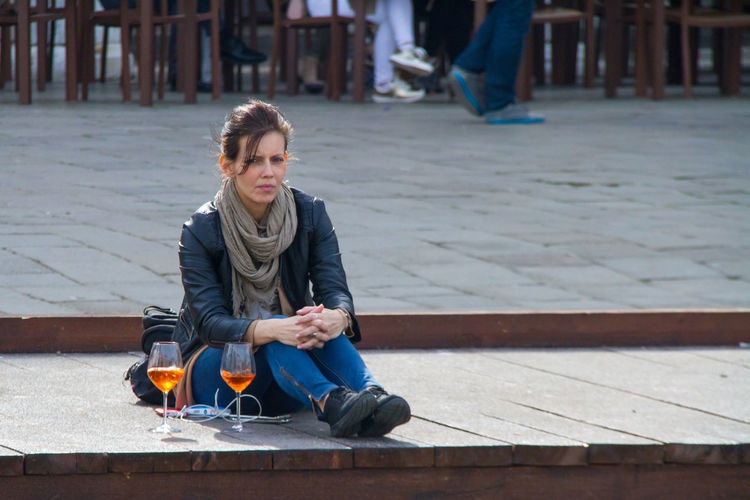 Having fun in Venice Casual Clothing Girl Lifestyles One Person Outdoors People Saturday Evening Sitting Spring In Venice Venice Canals Wine Not EyeEmNewHere