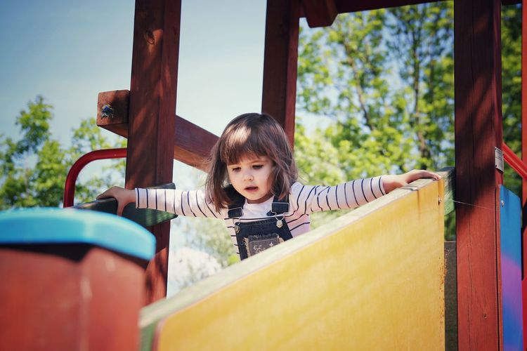 Portrait of happy girl playing on playground