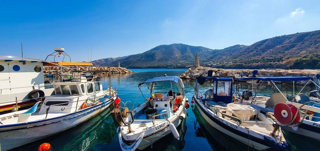 Panoramic view of boats moored in harbor
