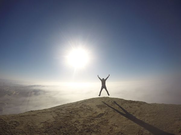 Arms Raised Sun Tranquil Scene Nature Leisure Activity Lifestyles Outdoors Beauty In Nature Real People Men Scenics Sunlight One Person Silhouette Day Sky Healthy Lifestyle