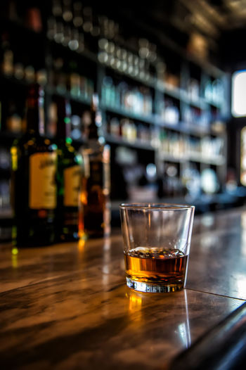 Irish whisky on a bar Alcohol Bar - Drink Establishment Bar Counter Close-up Day Drink Drinking Glass Focus On Foreground Food And Drink Food And Drink Industry Freshness Indoors  Liqueur No People Refreshment Shot Glass Table Whiskey