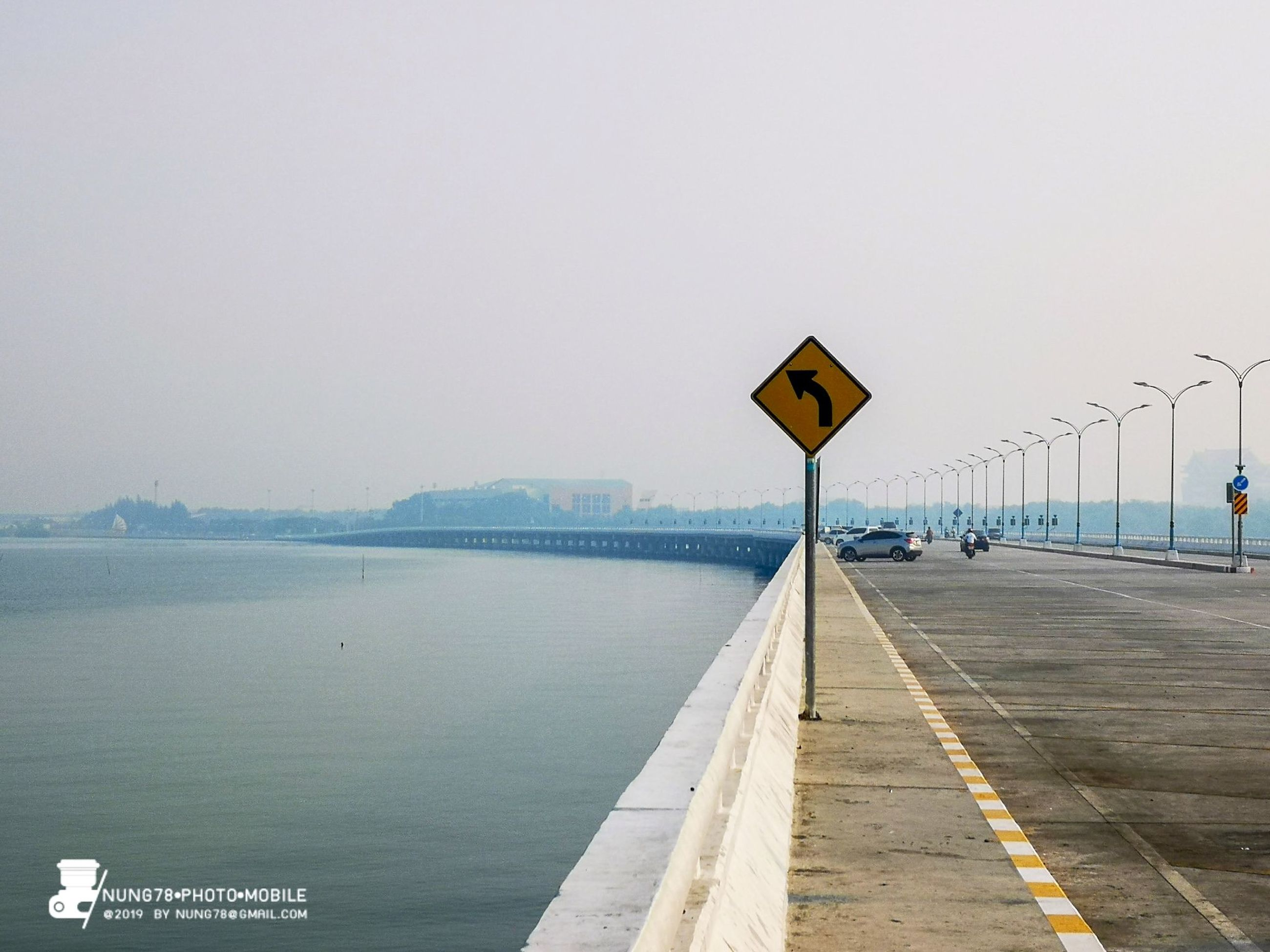 sign, sky, water, communication, copy space, clear sky, nature, transportation, day, built structure, no people, direction, architecture, road, outdoors, sea, road sign, guidance, the way forward