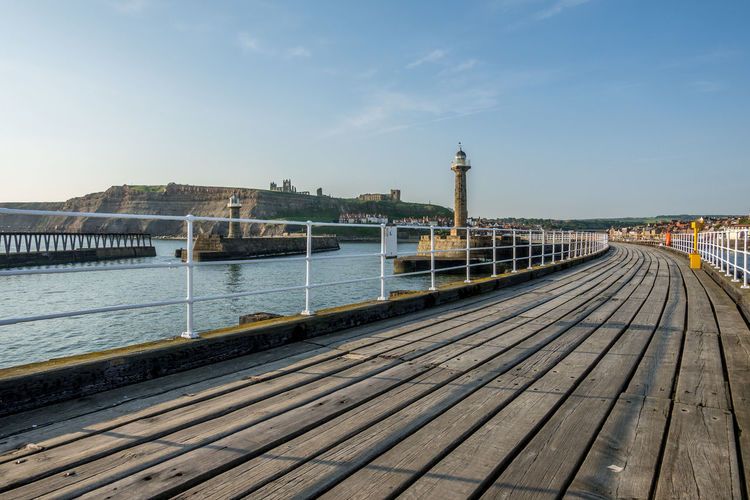 Whitby Whitby View Whitby North Yorkshire North Yorkshire North Yorkshire Coast Yorkshire Seaside Seaside Town Lighthouse Whitby Pier Tower Railing Outdoors Sky Architecture Day River No People The Way Forward