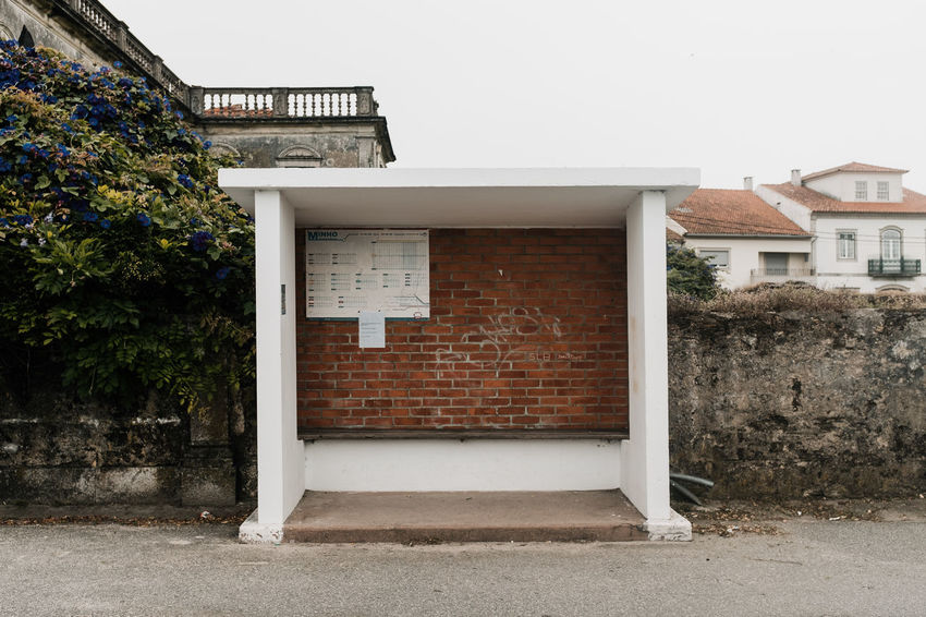 LOST IN GALICIA 🚌 Lostingalicia Threeweeksgalicia Bus Stop Architecture Built Structure No People Day Nature Outdoors Plant Tree Building Exterior Building House Residential District Window Wall - Building Feature Sky Entrance Wall Brick City Door
