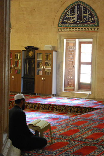 One Person Sitting Indoors  Window Carpet - Decor Real People Architecture Home Interior Building Domestic Room Relaxation Lifestyles Adult House Flooring Day Built Structure Full Length Reading Selimiye Selimiyecamii Selimiye Mosque Quran Islam Islamic Architecture
