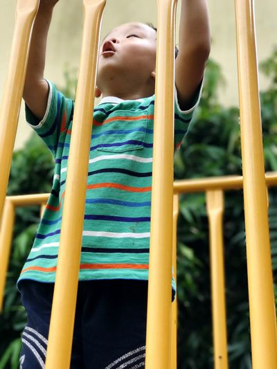Close-Up Of Boy Playing At Playground