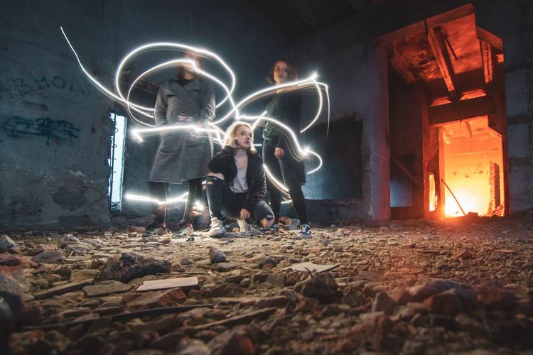 Night time Illuminated Night Men Full Length Glowing Two People Real People Motion Standing Long Exposure Casual Clothing Architecture People Togetherness Males  Lifestyles Built Structure Women Child Leisure Activity