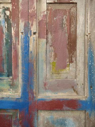 multi colored wooden door Backgrounds Weathered Old Full Frame No People Wood - Material Textured  Damaged Paint Day Abandoned Architecture Door Run-down Close-up Entrance Outdoors