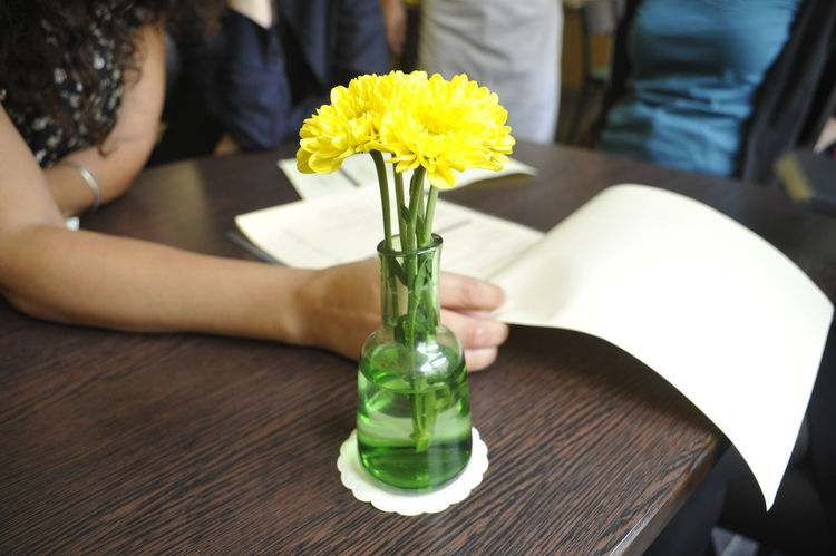 Meeting with flower. Flower Hands Meeting Friends Paper Table Work Meeting Yellow