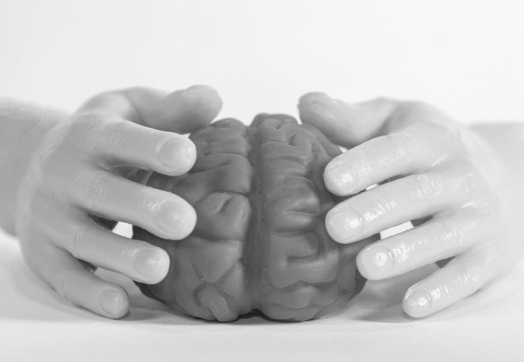 Close-up of people hands over white background