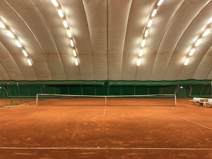 Empty illuminated tennis court