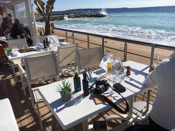 Lunch on the beach on Cannes in winter Lunch On The Beach Table Sea Chair Dining Table Place Setting Water Outdoors Beach No People Horizon Over Water Furniture