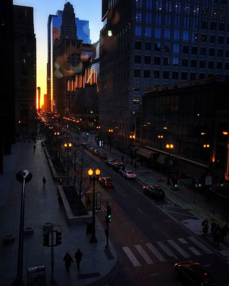 Looking down evening edition Sunset Chicago Illuminated Architecture Building Exterior City Street Built Structure Night Skyscraper City Street Road Cityscape