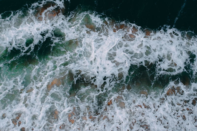 aerial view of sea waves water texture background Motion Sea Aquatic Sport Water Surfing Sport Nature Beauty In Nature Blurred Motion Wave Day High Angle View Full Frame Rock Scenics - Nature Splashing Outdoors Land Power In Nature Breaking Flowing Water
