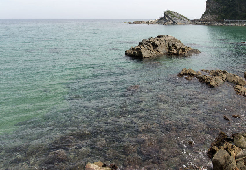 """famous seaside called """"Badabuchaegil"""" at Jeongjdongjin in Gangreung, Gaongwondo, South Korea Badabuchaegil Gangreung Jeongdongjin Beauty In Nature Coast Day Horizon Over Water Nature No People Outdoors Rock - Object Rock Formation Scenics Sea Seaside Sky Tranquil Scene Tranquility Water"""