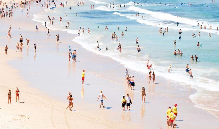 Group of people enjoying at beach