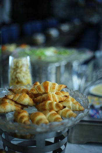 Close-up of fresh croissants in glass bowl during buffet at restaurant