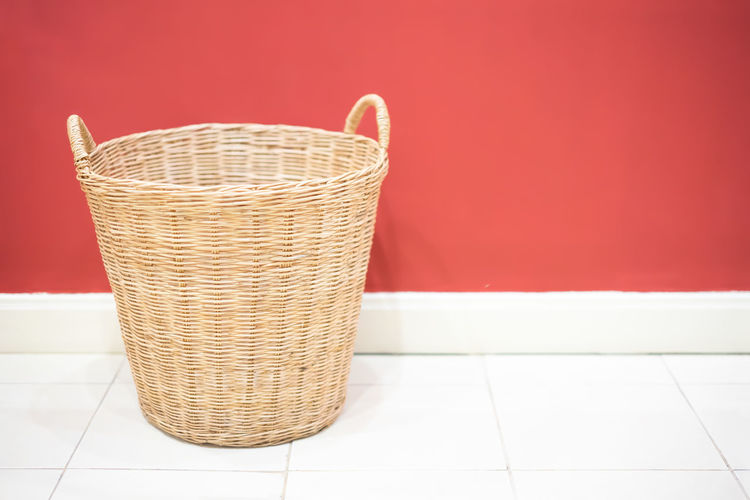 Wicker basket in laundry room Wash Pile Messy Material Housework Domestic Household Box Decor Modern Storage Cozy Fabric Room Laundry Home Indoors  Wooden Nobody Interior Style Life House Plastic Filter Living Table Details Background Basket Object Isolated White Empty Symbol Bucket Bin Brown Sign Design Clean Concept Container Wicker Decoration Vintage Texture Wood Food Red
