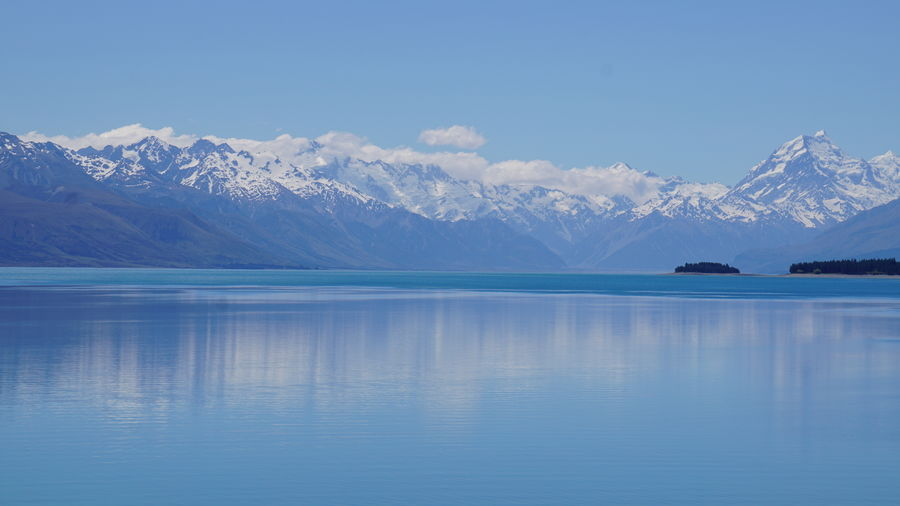 Reflections of the New Zealand Alps in Lake Pukaki. Aoraki Mount Cook Aoraki Reflection Beauty In Nature Blue Glacier Idyllic Lake Mirror Lake Mount Cook Mount Cook National Park Mountain Mountain Range Nature No People Outdoors Plethora Of Colour Pukaki Scenics Snow Snowcapped Mountain Tranquil Scene Tranquility Water