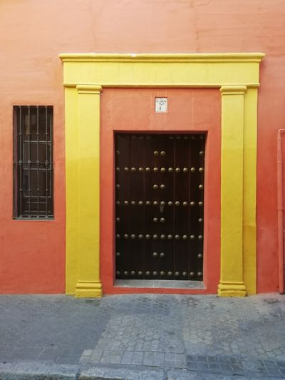 Architecture Built Structure Building Exterior Building Entrance Door Window No People Footpath Day Yellow Sidewalk Closed Residential District Outdoors Protection City Orange Color House Red The Architect - 2019 EyeEm Awards