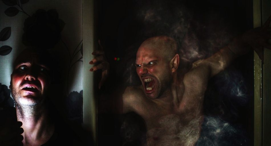 Zombie scaring man at night