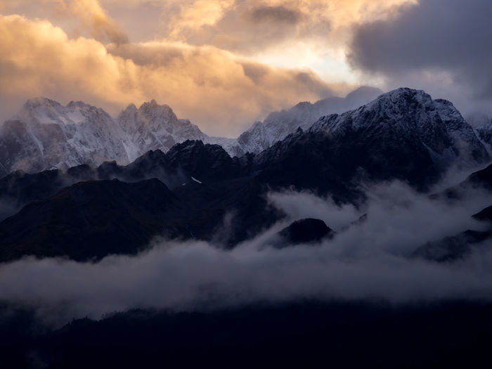 Low angle view of mountains against dramatic sky