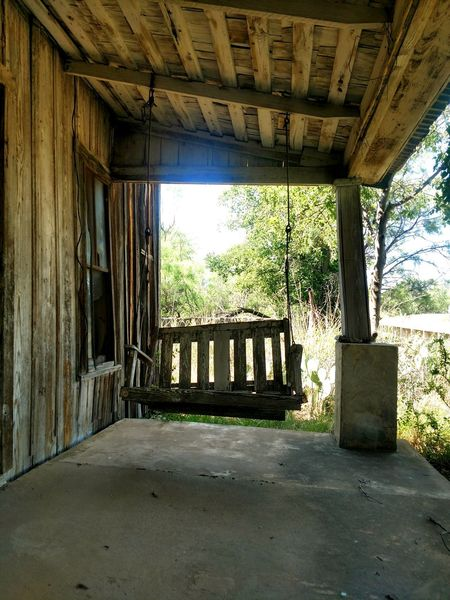 My swinging days are over. Sitting Outside Texas Ghost Town Porch Swing Swinging Swings Porch Swing Wooden Wooden Post Wooden House Wooden Swing Rustic Abandoned Places Abandoned & Derelict Abandoned House Architectural Column Architecture Built Structure Historic Old Ruin Deterioration Worn Out Bad Condition Weathered