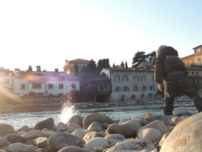 Architecture Building Exterior Built Structure Casual Clothing Clear Sky Day Fountain Full Length In Front Of Motion Outdoors Rock - Object Shore Splashing Spraying Water