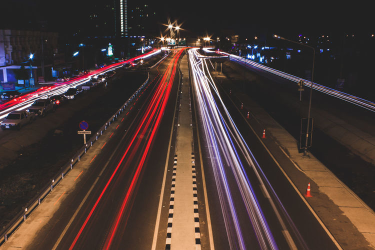 First Eyeem Photo Built Structure Motion Glowing Traffic Outdoors Night Speed Street Illuminated Long Exposure Light Trail Transportation Highway No People Blurred Motion High Angle View Architecture Diminishing Perspective Bridge - Man Made Structure The Way Forward Road Multiple Lane Highway City Life Vehicle Light